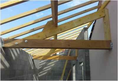 Construction d'un garage avec toiture à une pente accolé à un pavillon